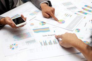 finger pointing to data paperwork - Waypath