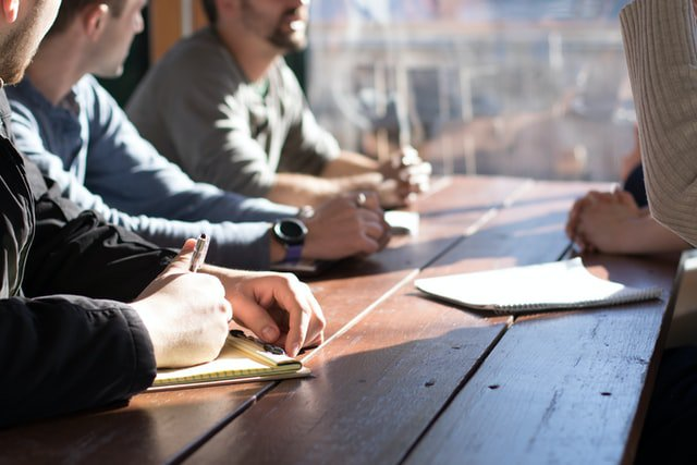 people at a table meeting - development team -WayPath Consulting