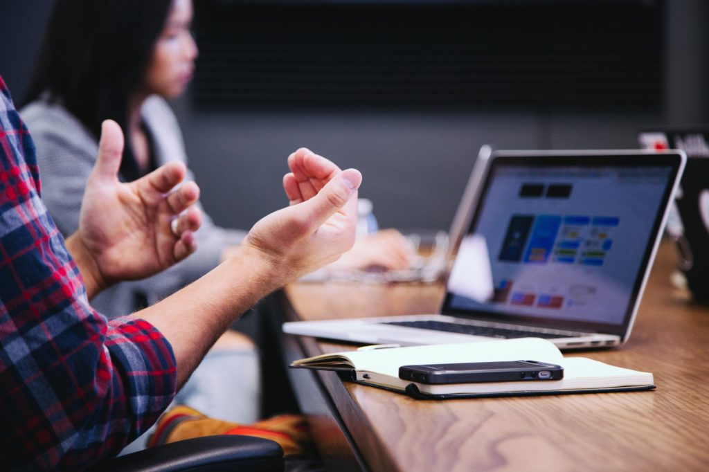 hands moving in front of open laptop - opentext -CCM - Waypath Consulting