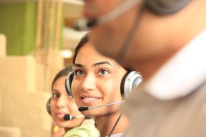 3 people with headsets on | Customer Communications Management Software | WayPath Consulting